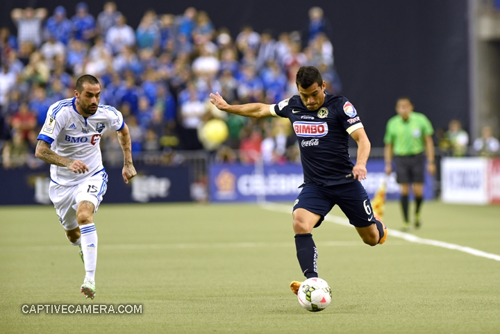 Montreal, Canada - April 29, 2015: Andres Romero #15 of Montreal Impact chases down Miguel Samudio #6 of Club America.