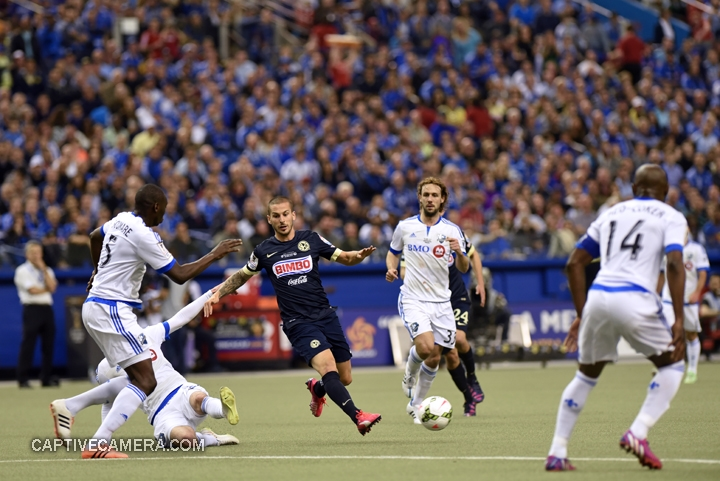 Montreal, Canada - April 29, 2015: Dario Benedetto #9 of Club America evades a tackle from Montreal Impact opposition.