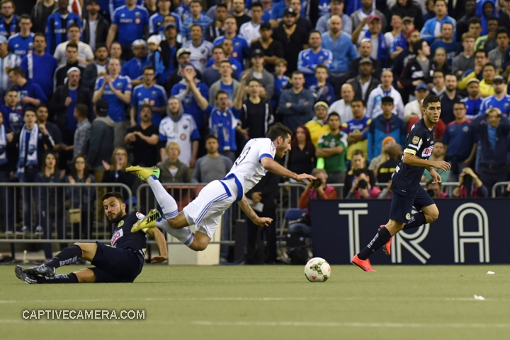 Montreal, Canada - April 29, 2015: Ignacio Piatti #10 of Montreal Impact is fouled by Jose Guerrero #21 of Club America.