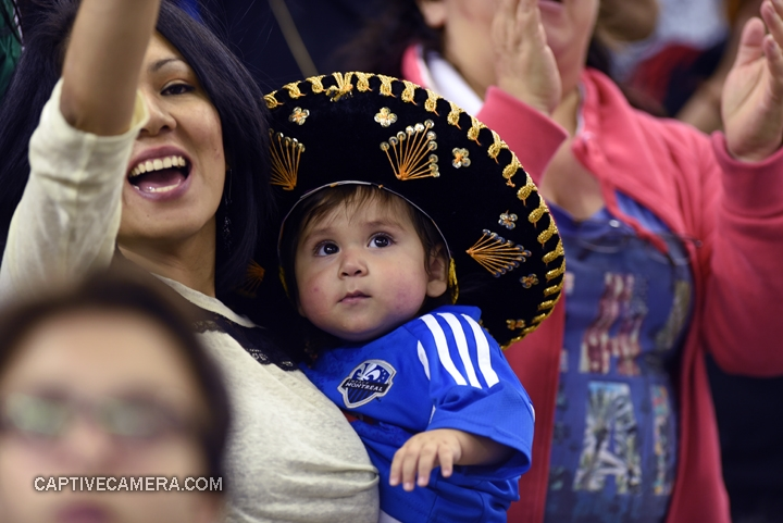 Montreal, Canada - April 29, 2015: A young diplomatic fan supports both Montreal Impact and Club America.