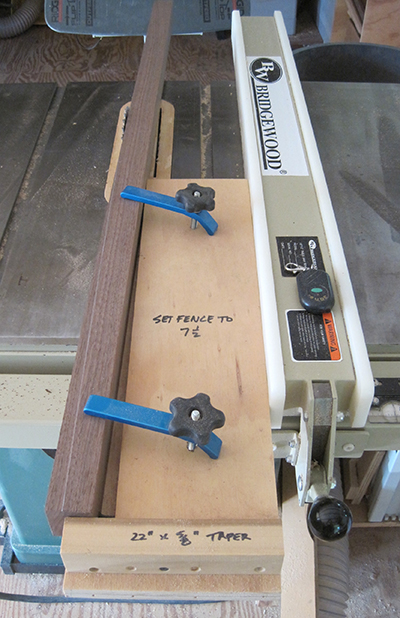 The rear leg bending blank being tapered on the table saw