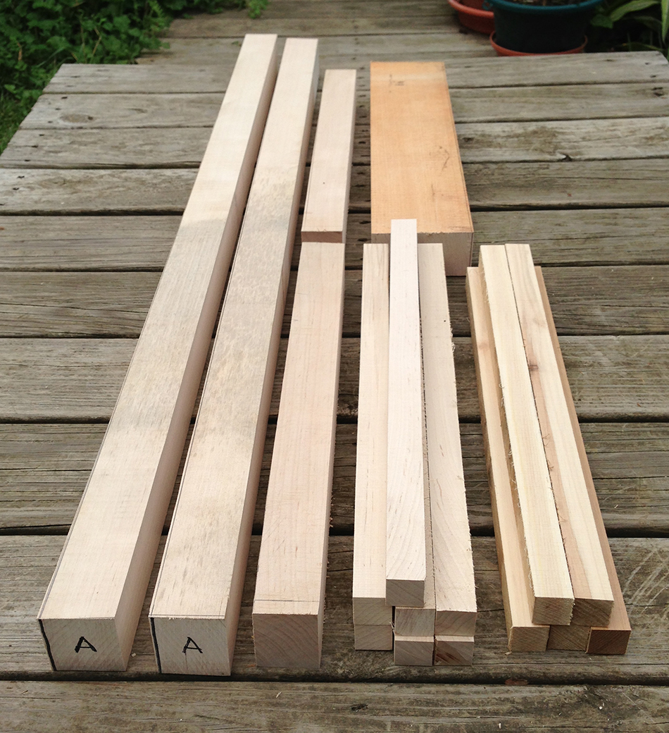 Blank parts for a side chair from left: rear legs, front legs, slats, and rungs