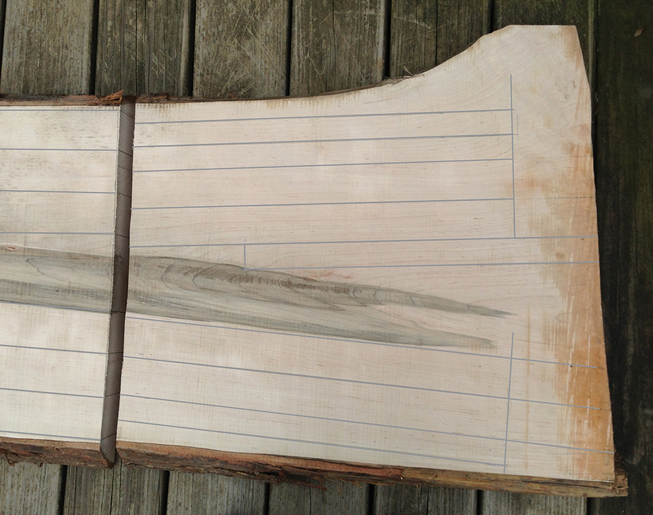 Front legs and rungs laid out on a 2 foot section of rift sawn wood