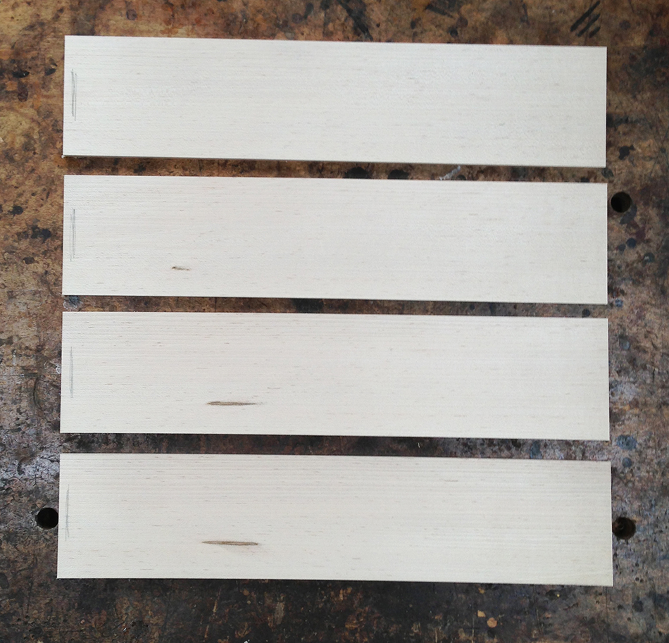 The final four slat blanks. The pencil mark on the left side of each slat helps me orient the slat correctly in the bending form.