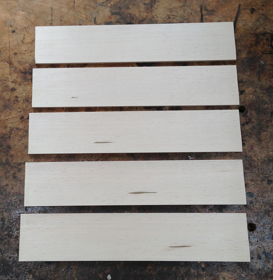 Five slats in the order in which they were cut from the blank.
