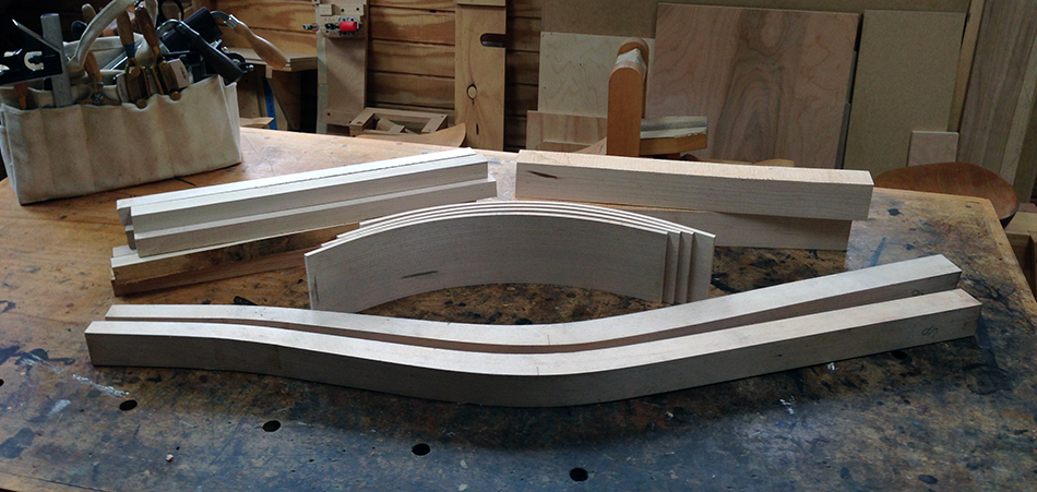 The chair so far: rear legs (front), slats (middle), rung blanks (back on left), and front leg blanks (back on right)