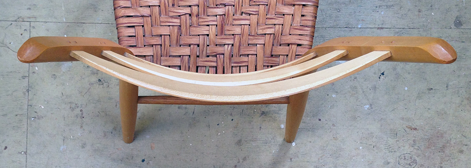 In this chair the lower slat tilts forward forcing it out of alignment with the middle and upper slats