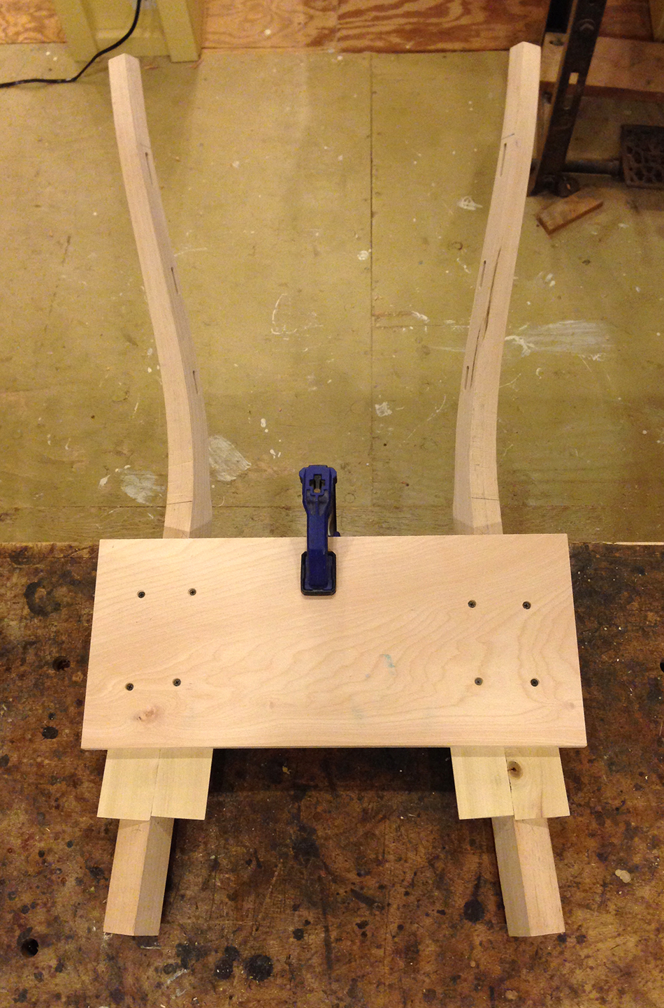 This jig holds the rear legs in the same position the legs will occupy in the finished chair