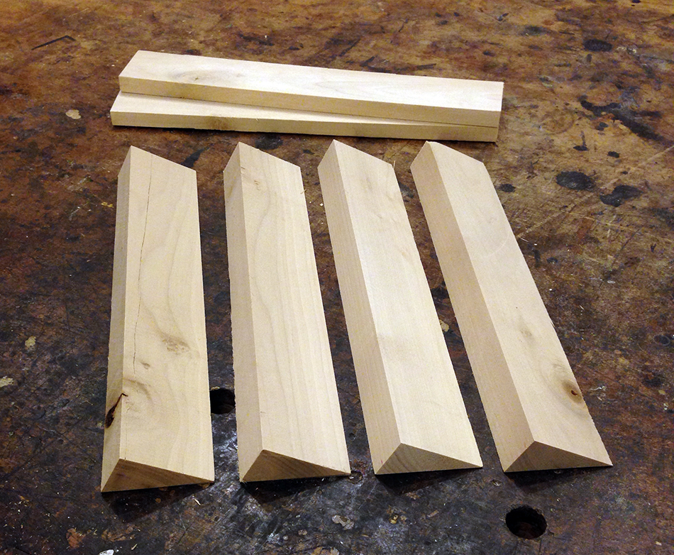 A complete set of four support blocks. The remaining material (behind the support blocks) will be used to make a measuring jig.