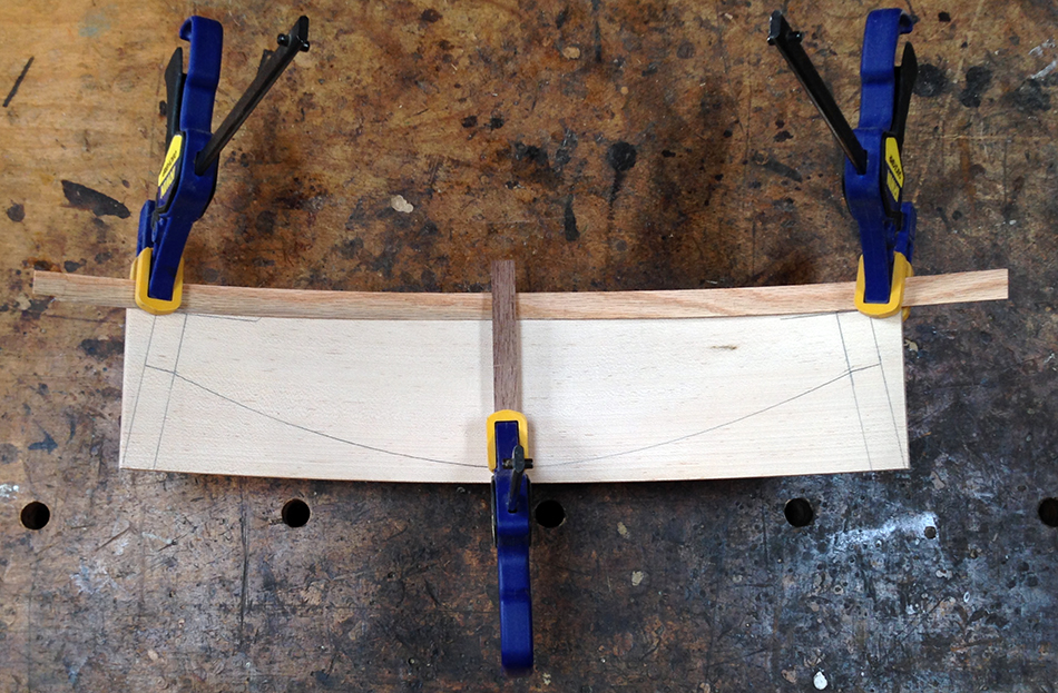Draw the bottom arc of the slat using a thin bent strip of wood as a guide