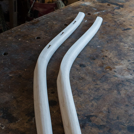 The rear legs are shaped from square to round with drawknife, spokeshave, and scraper