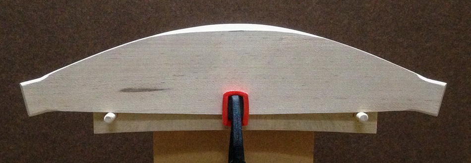 Shaping the slats: The bevel is begun in the center down to the reference mark and two thirds of way back on the top edge