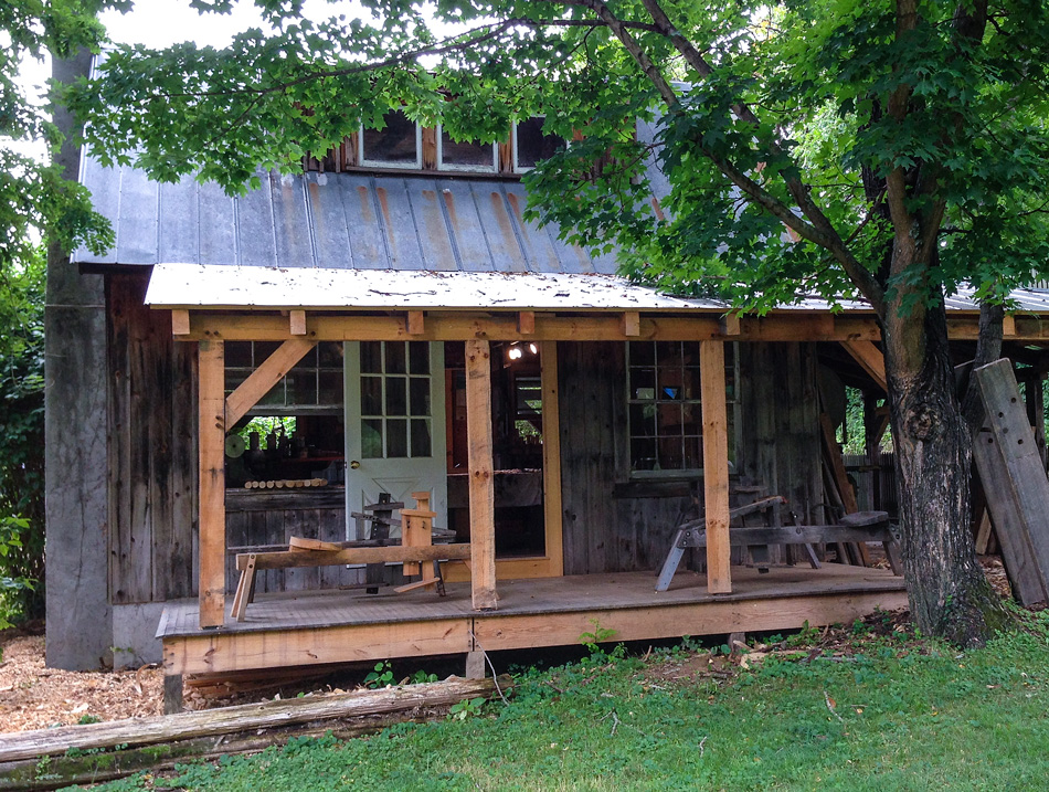The back porch of Curtis Buchanan's shop with four shavehorses