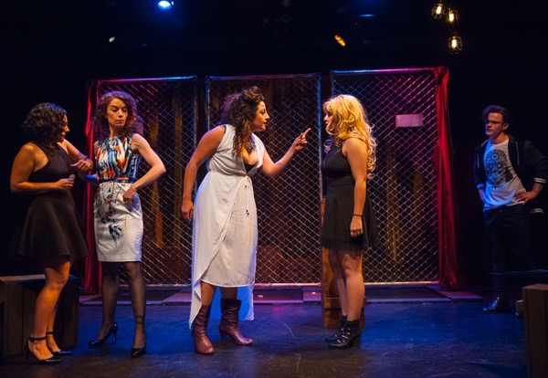 British Jasmine scolds her Moldovan slave Yuliana as others look on in a theatre bar in London in Silva Semerciyan's   Turning Tricks  , directed by Erin Gilley (L to R: Roneet Aliza Rahamim, Emily Keyishian, Denmo Ibrahim, Naseem Etemad, Adam Roy).