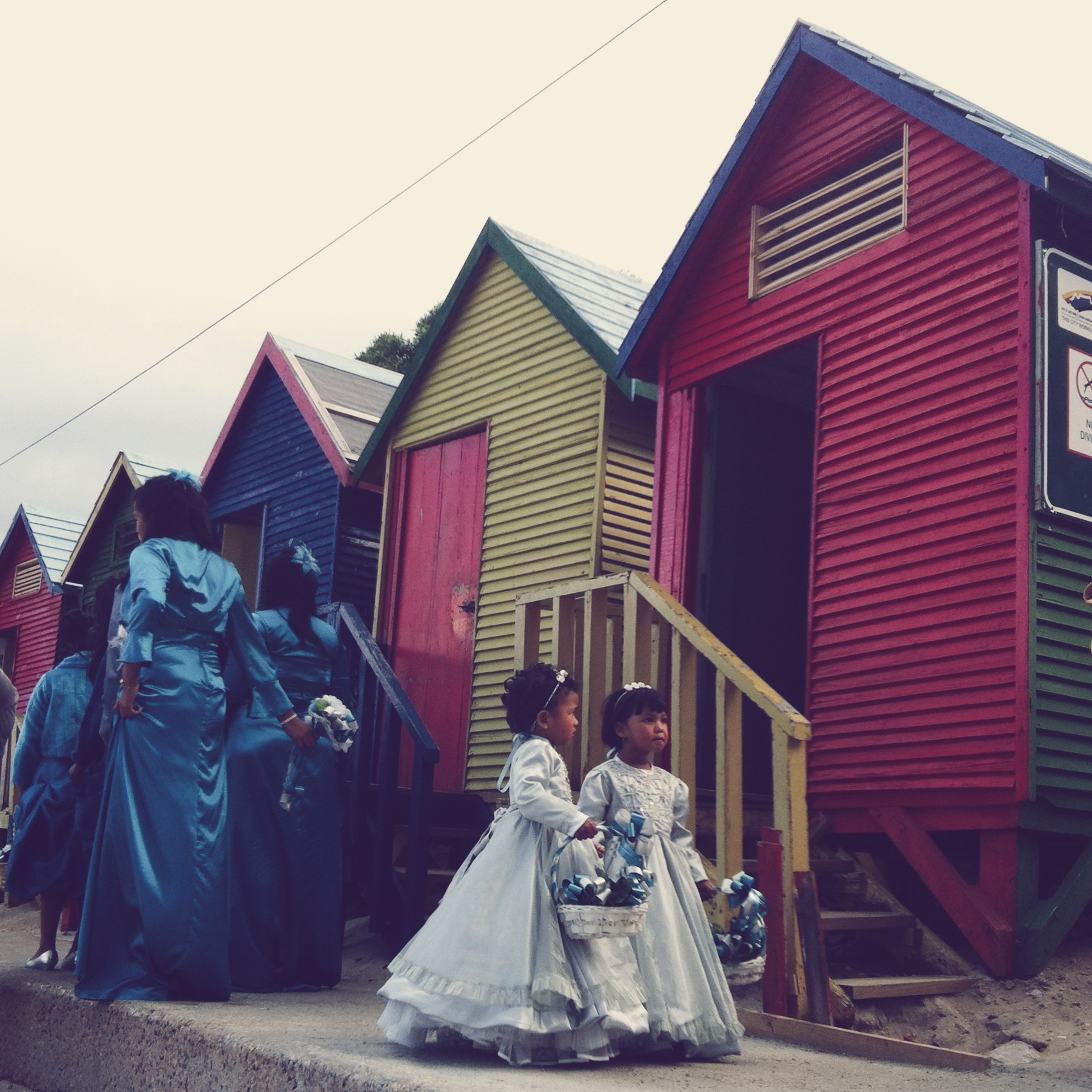 If you're lucky, on Saturdays you might spot a wedding party having their photos taken at the huts. These two little flower girls were being given strict instructions by a supervising aunty while the bridesmaids in blue satin walked off to pose on the stairs.