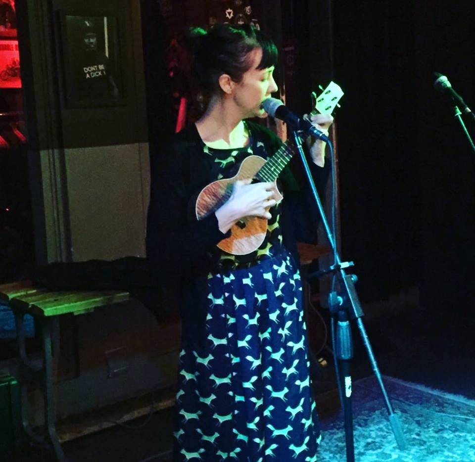 Me in a dress I made, playing at House of Machines in Cape Town at an open mic.