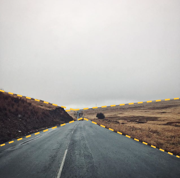The lines of road create a triangle shape meeting in the middle of the shot.
