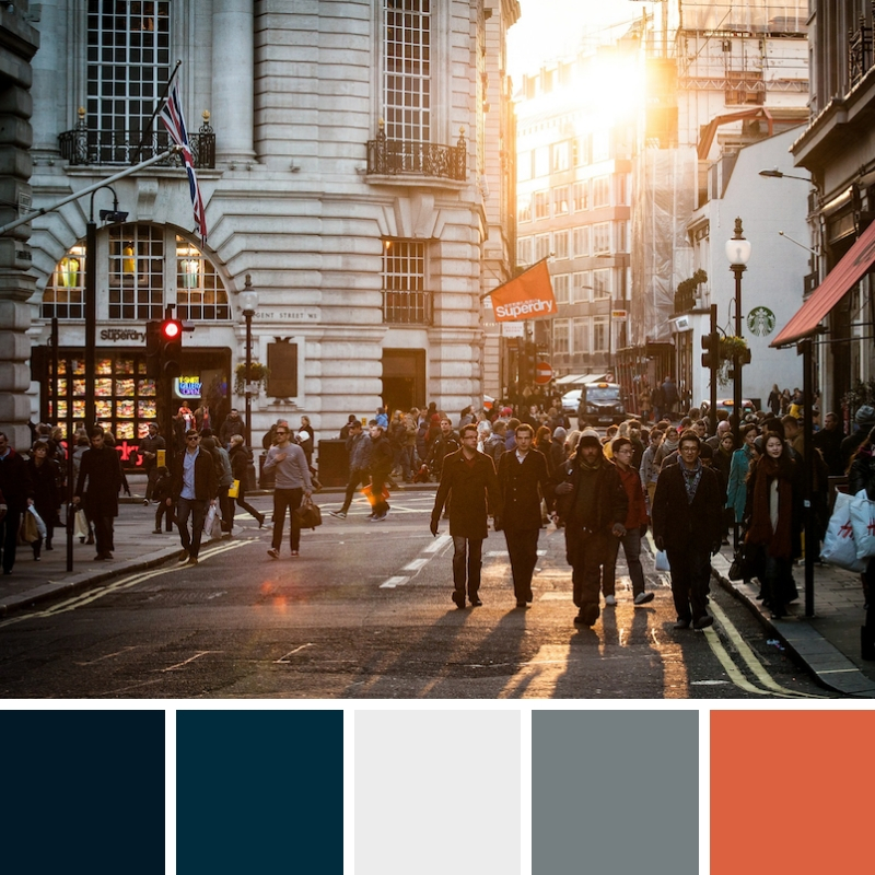 Colour palette of dark blues, greys, cream and coral/orange.