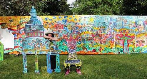 Artfest Show Producer, Loy MacDonald - sporting the 80 ft ParticiPAINT Mural!