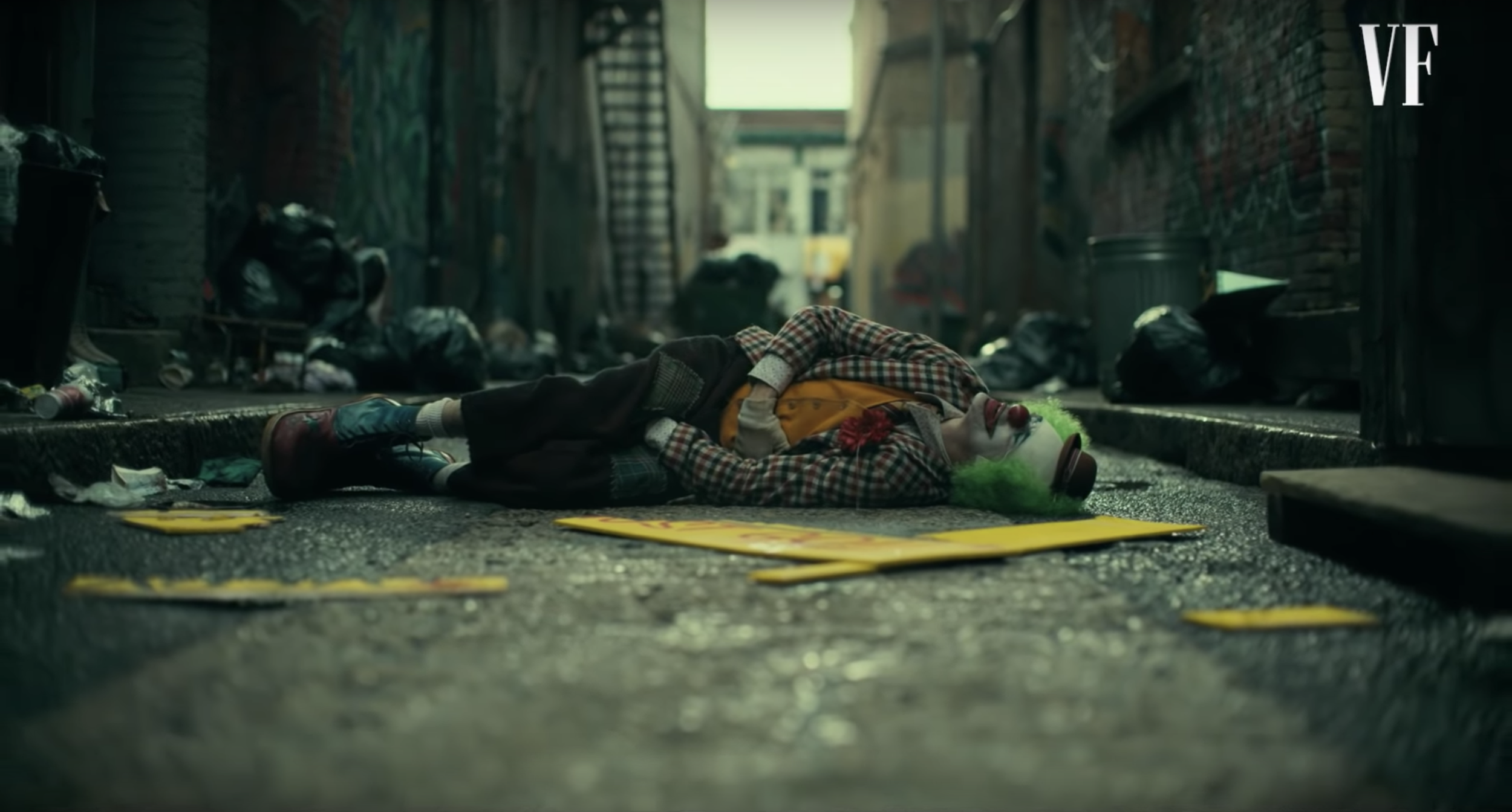 Joker (2019) beaten up and lying in an alley