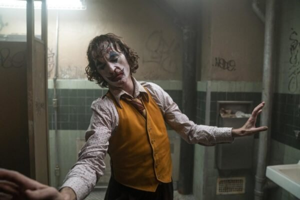 Joker dancing in men's bathroom