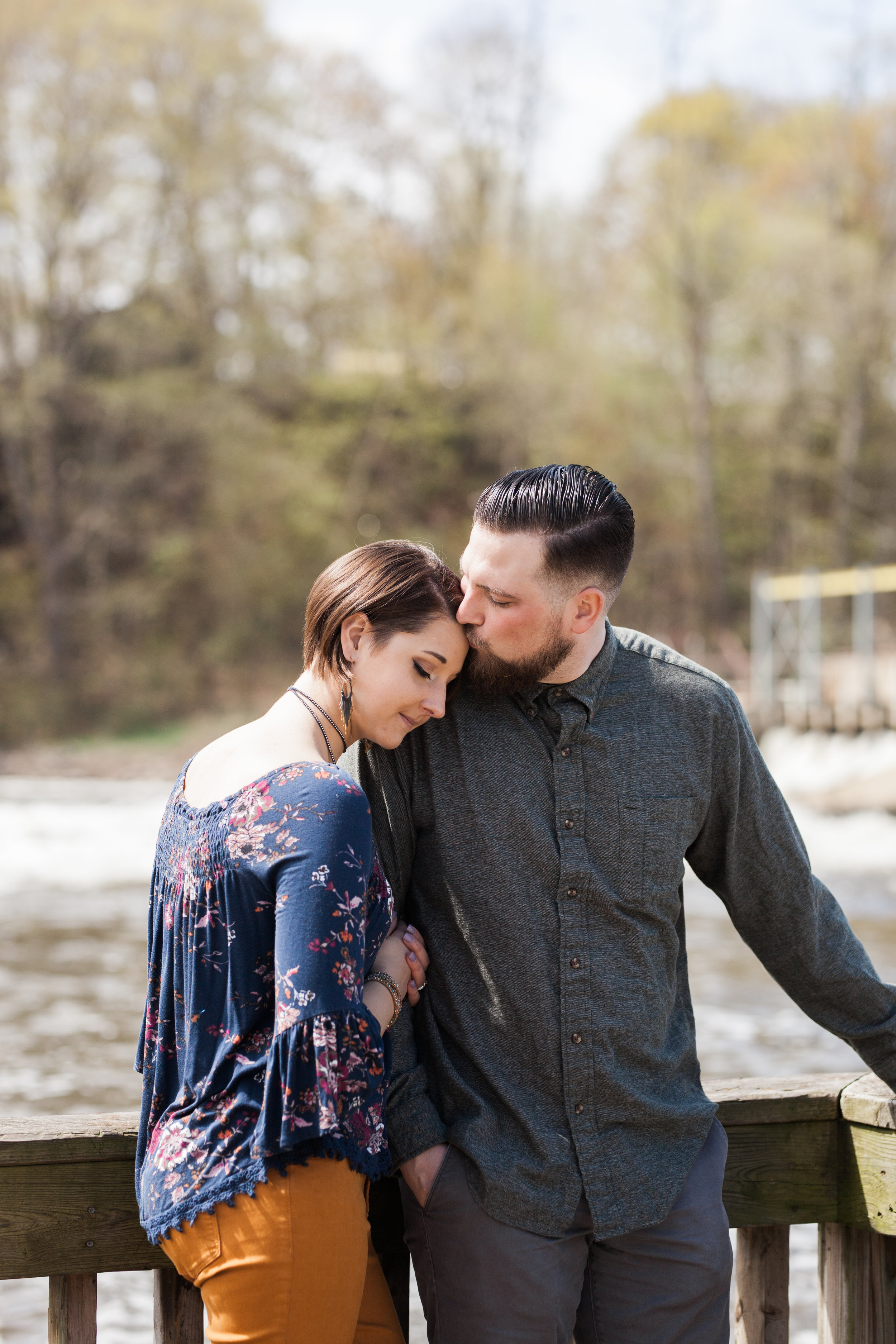forehead-kiss-engagement-session-downtown-allegan