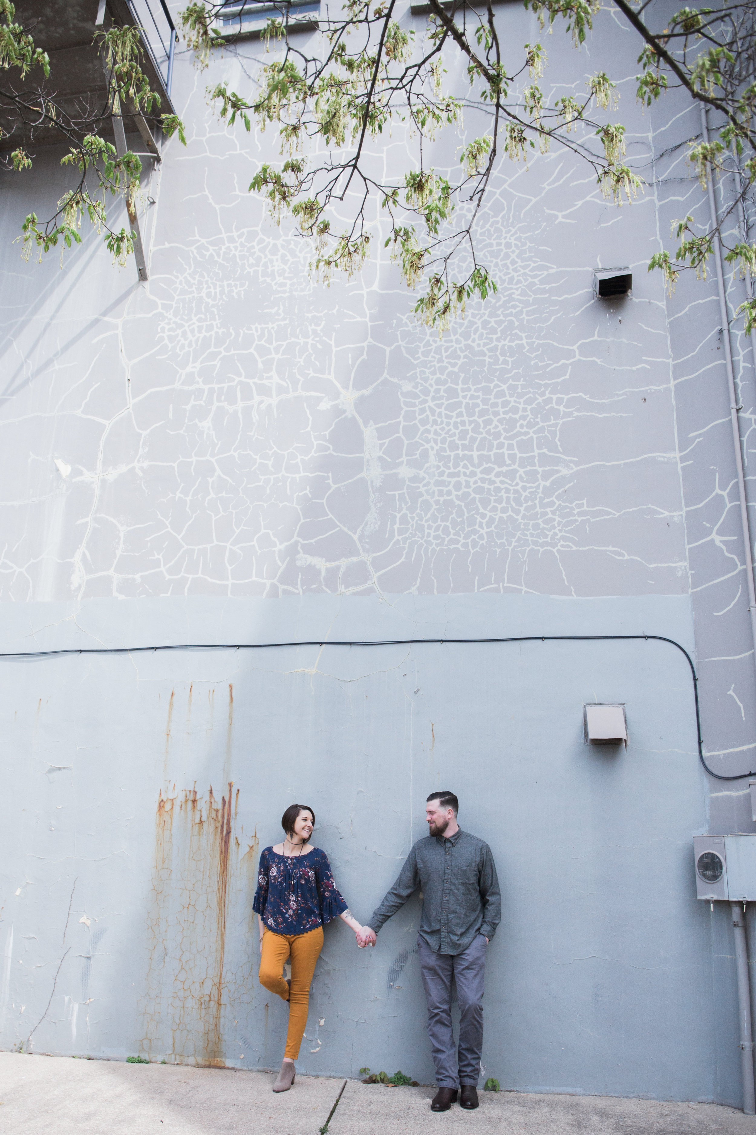 artistic-wall-engagement-session-downtown-allegan