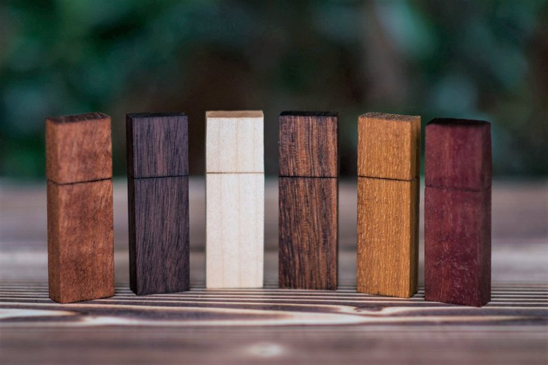 USB - Your wedding memories are curated on a USB 3.0 memory drive crafted from a choice of exotic woods. From left to right: sepele, walnut, maple, sucupira, iroko and maobi.