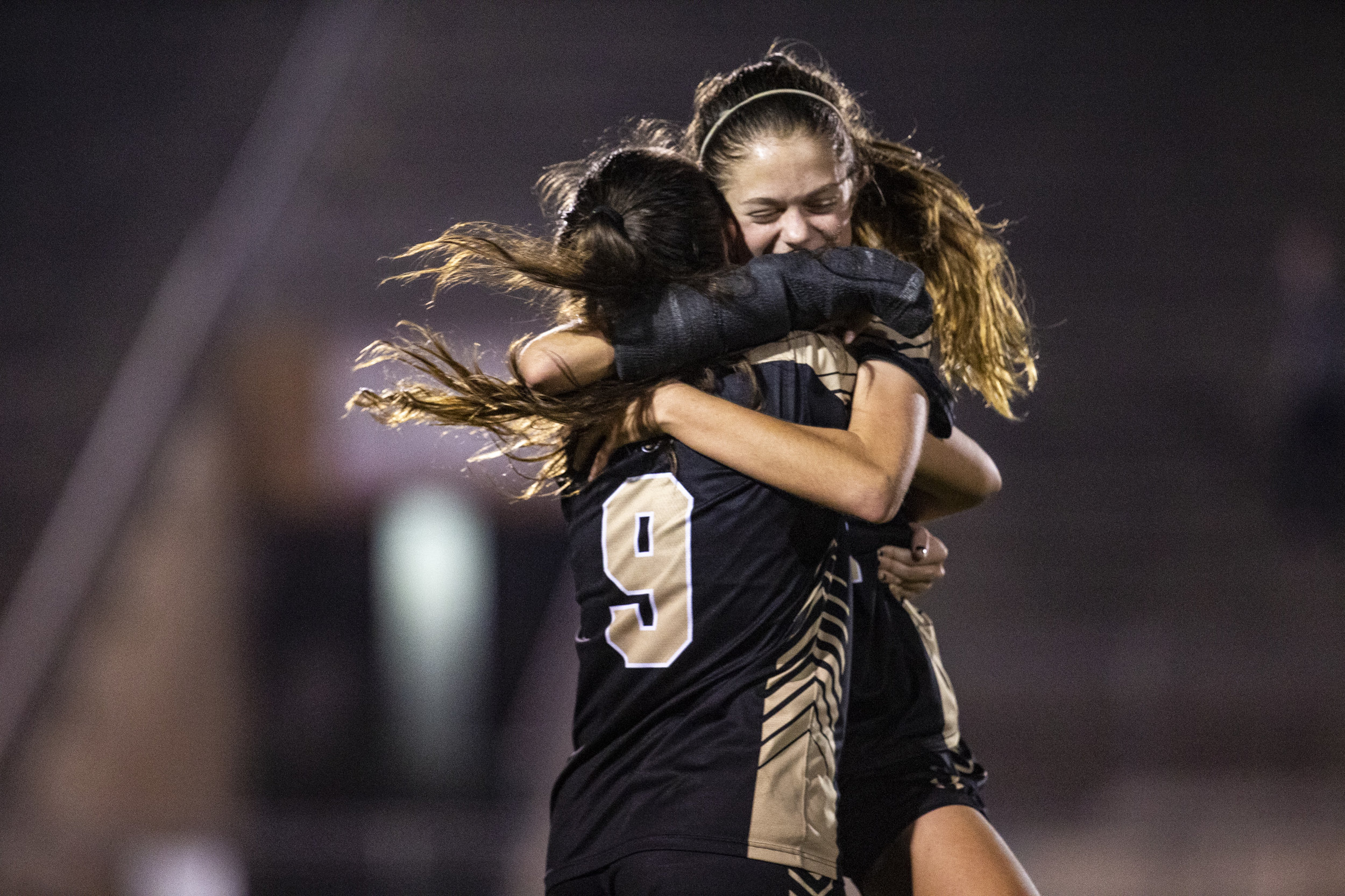 Buchholz's Victoria Schuh hugs Kate Johnson after the Class 5A girls soccer playoff game at Citizens Field on February 5, 2019. The Buchholz Bobcats won 1-0 over Flagler Palm Coast.
