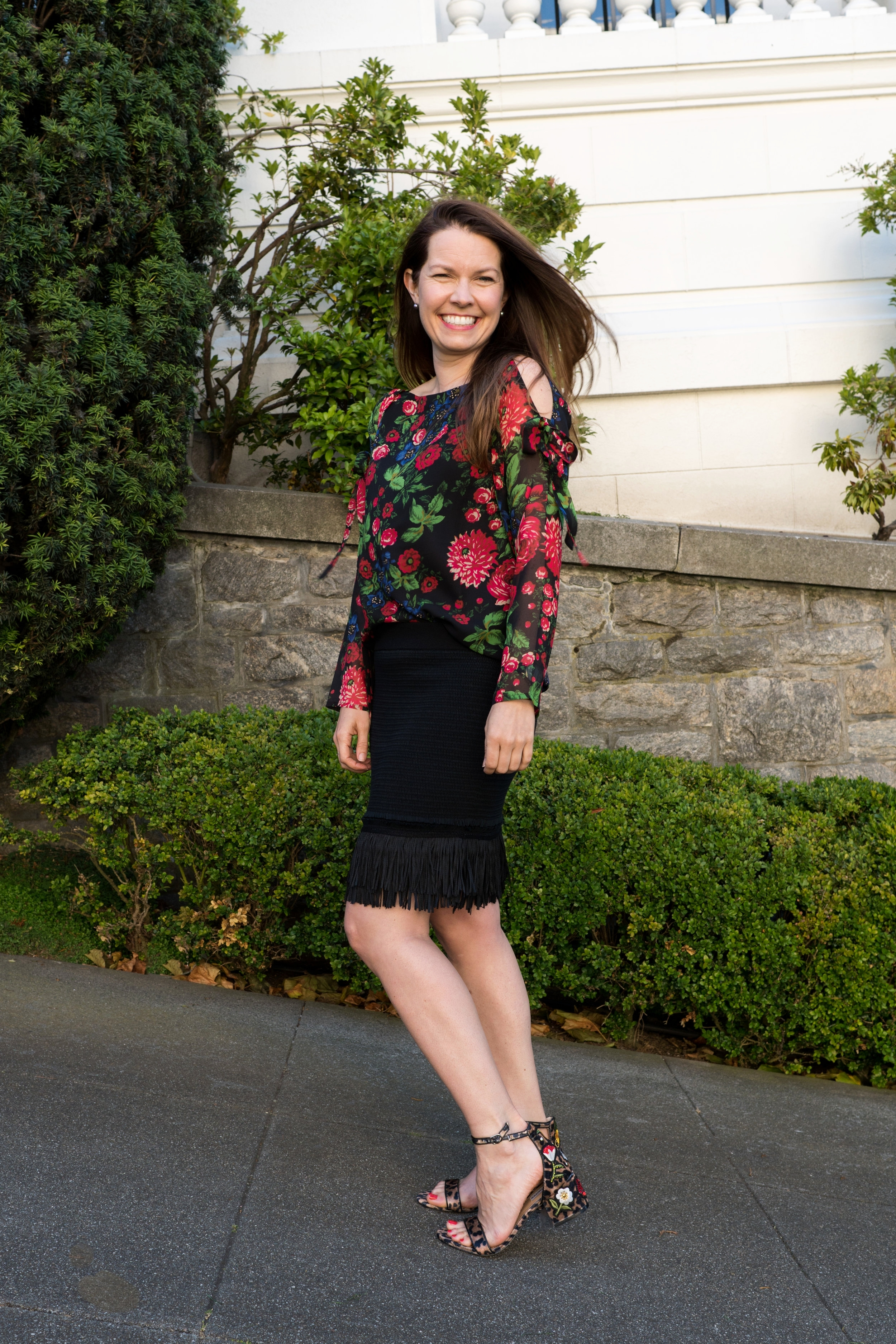 Outfit Details: Club Monaco  Fredrikah Fringe Sweater Skirt $129 (on sale),  Dolice Silk Blouse  $69 (on sale) and  Steve Madden Leopard Sandals  ($39.97)