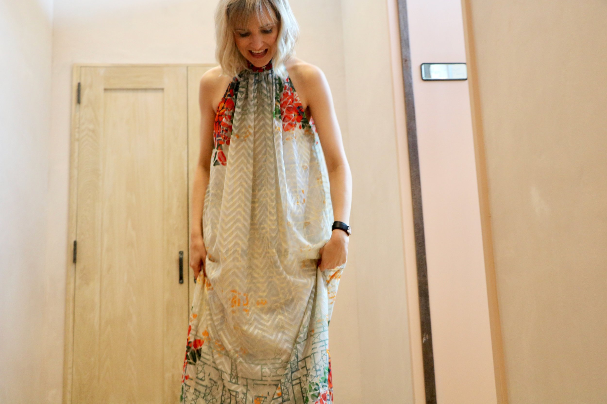 Megan's wearing the  Marilla Maxi Dress  $248 available at Antropologie