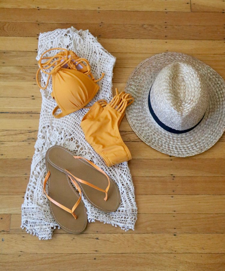 Outfit details:  Shein bikini,   crochet beach coverup , straw hat from Jamaica,  Old Navy flip flops .