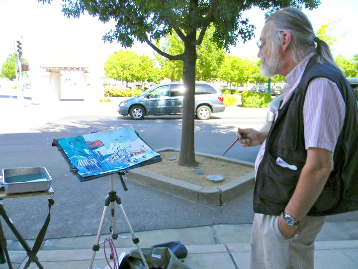 Artist on Sacramento street during previous Paint Lodi Event.