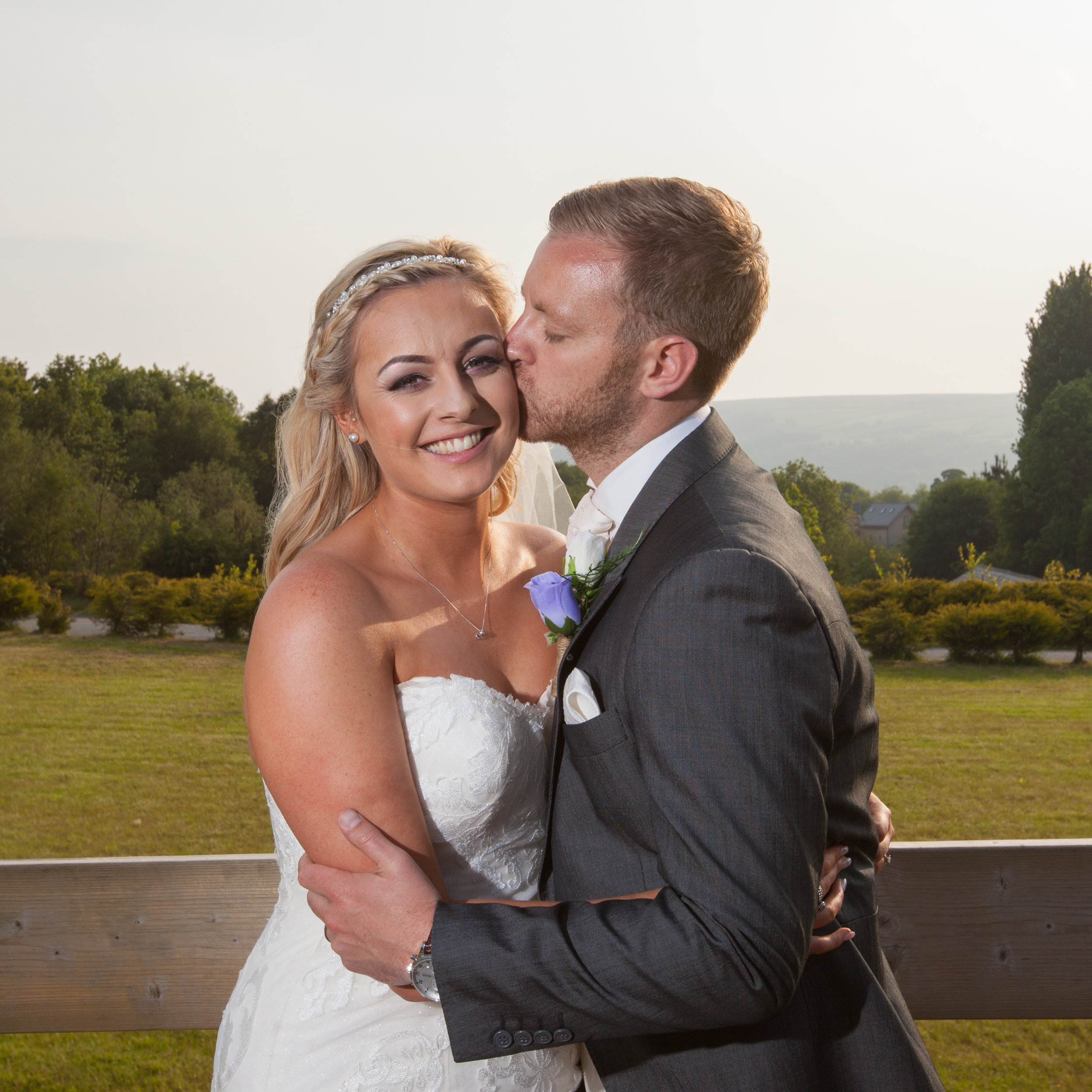 Bride and groom at the fishermans retreat at Edenfield ,Lancashire.