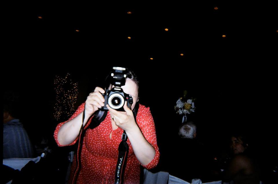 little girl with a disposable camera and me having a face-off photo-style :)
