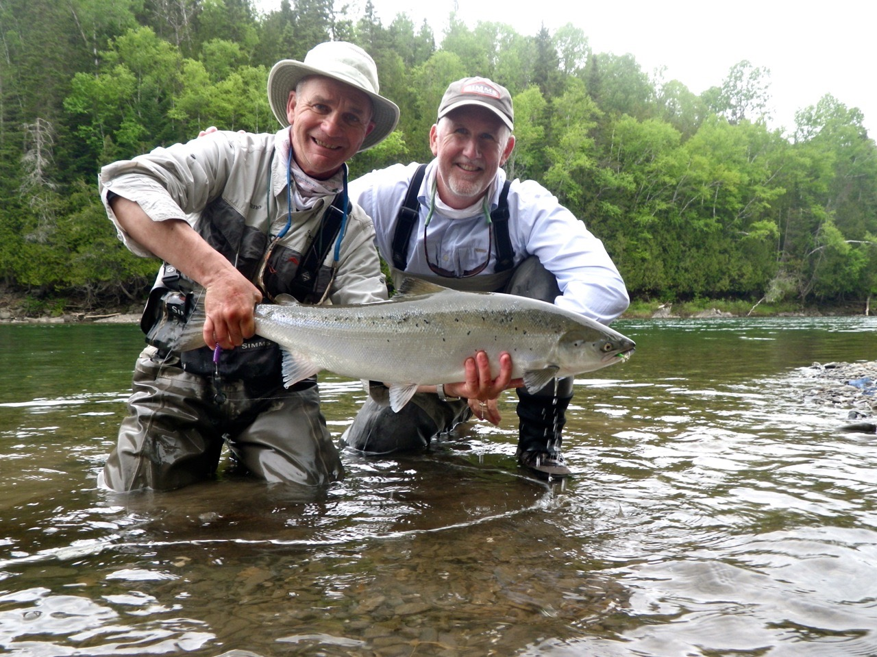 Photographer Tosh Brown  with Camp Bonaventure guide Bruno LePage. This is Tosh's first Atlantic Salmon, Congratulations!