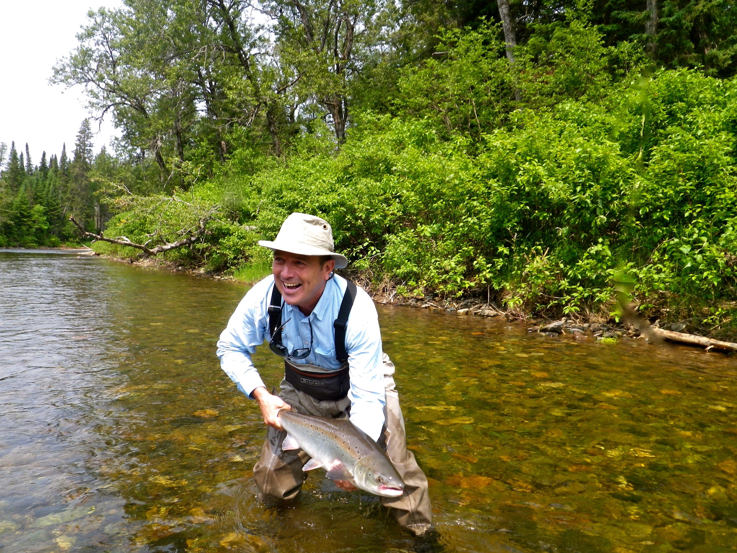 Claude Lachance puts a nice back on the Grand Cascapedia, Nice fish Claude!