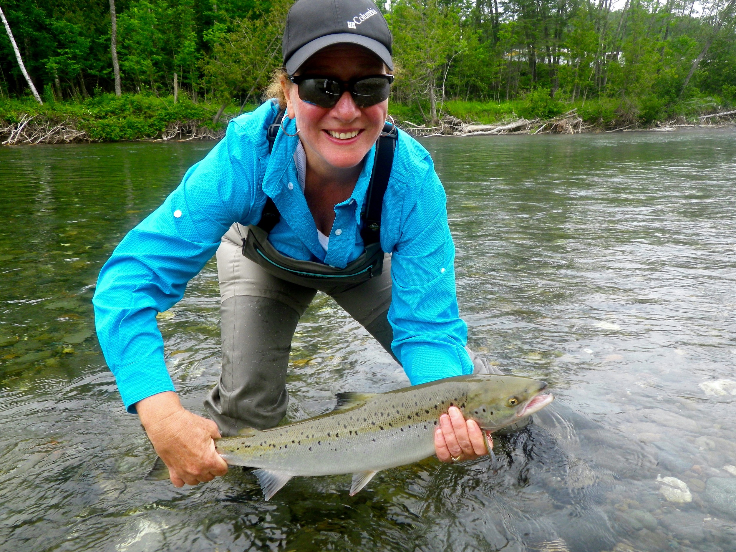 Françoise Duchense with her first salmon of the year, Nice fish Francoise!