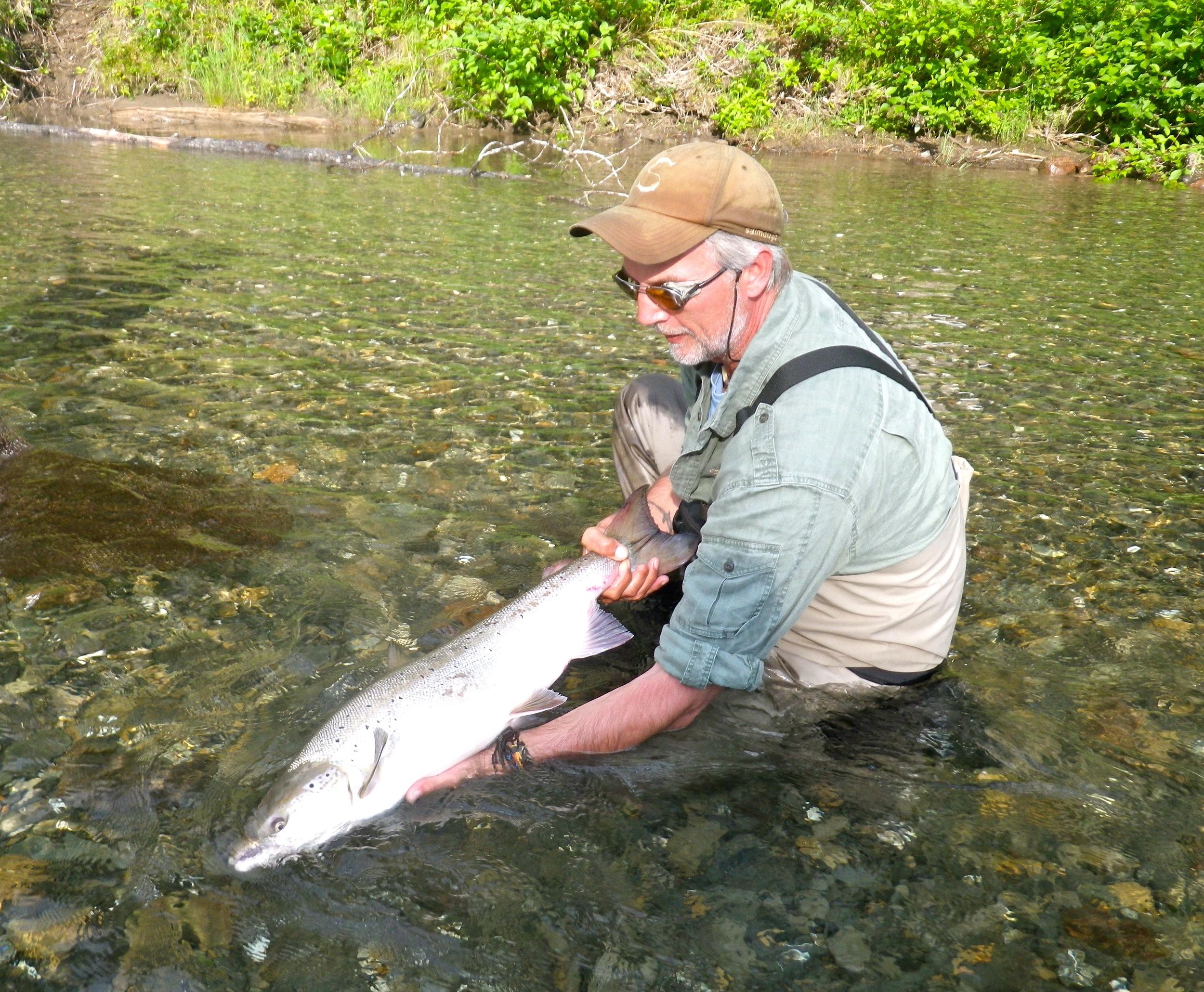 Henrik Mortensen lands his first Bonaventure salmon of the season, Congratulations Henrik, nice salmon!