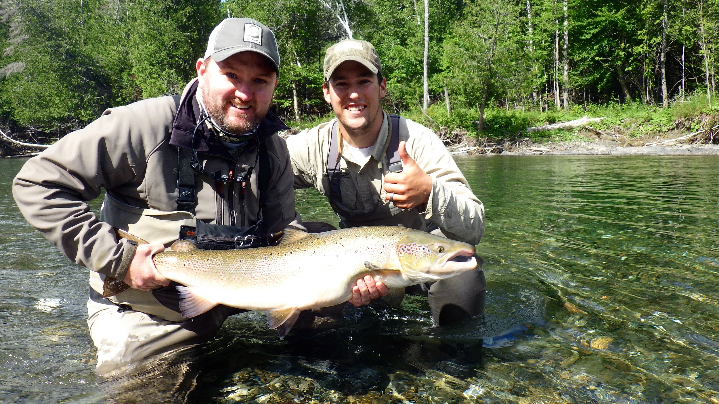 Matthew Gordon (Left) and Camp Bonaventure guide Robert Benwell pose with a nice one from the Petite. Nice salmon Matt!