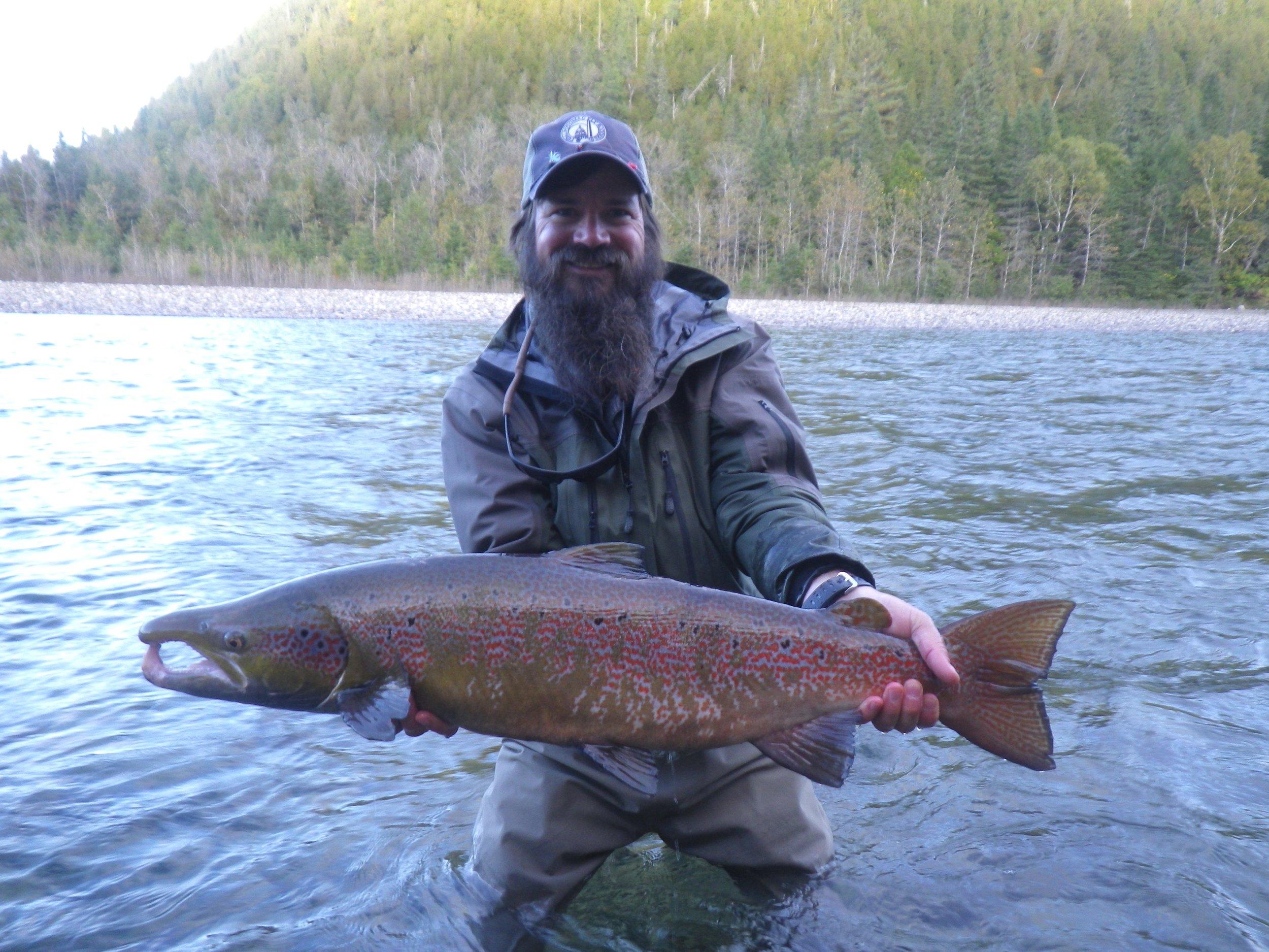 Dan Davala from Orvis Travel lands' this big male fish on the Bonaventure, wow, nice on Dan!