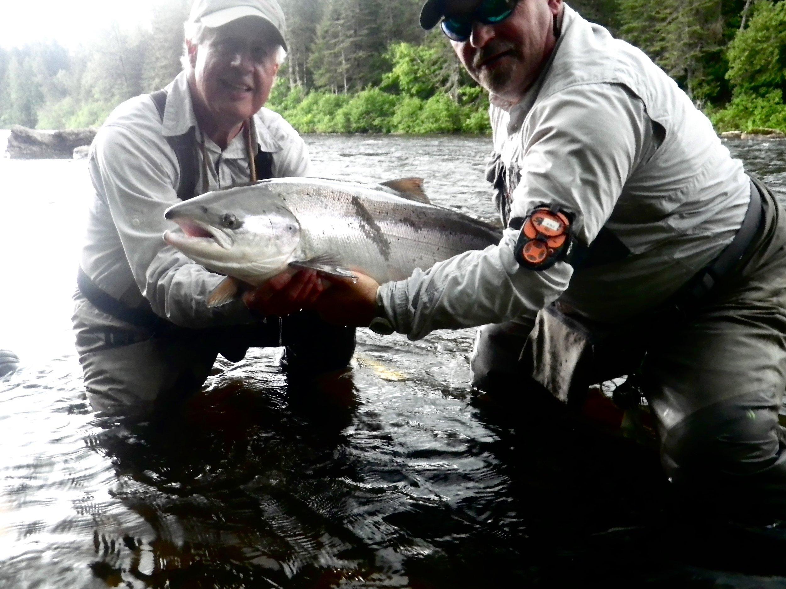 Camp Bonaventure regularJonathan Director (left) and master guide John Law with a beautiful fresh run salmon, congratulations Jon!
