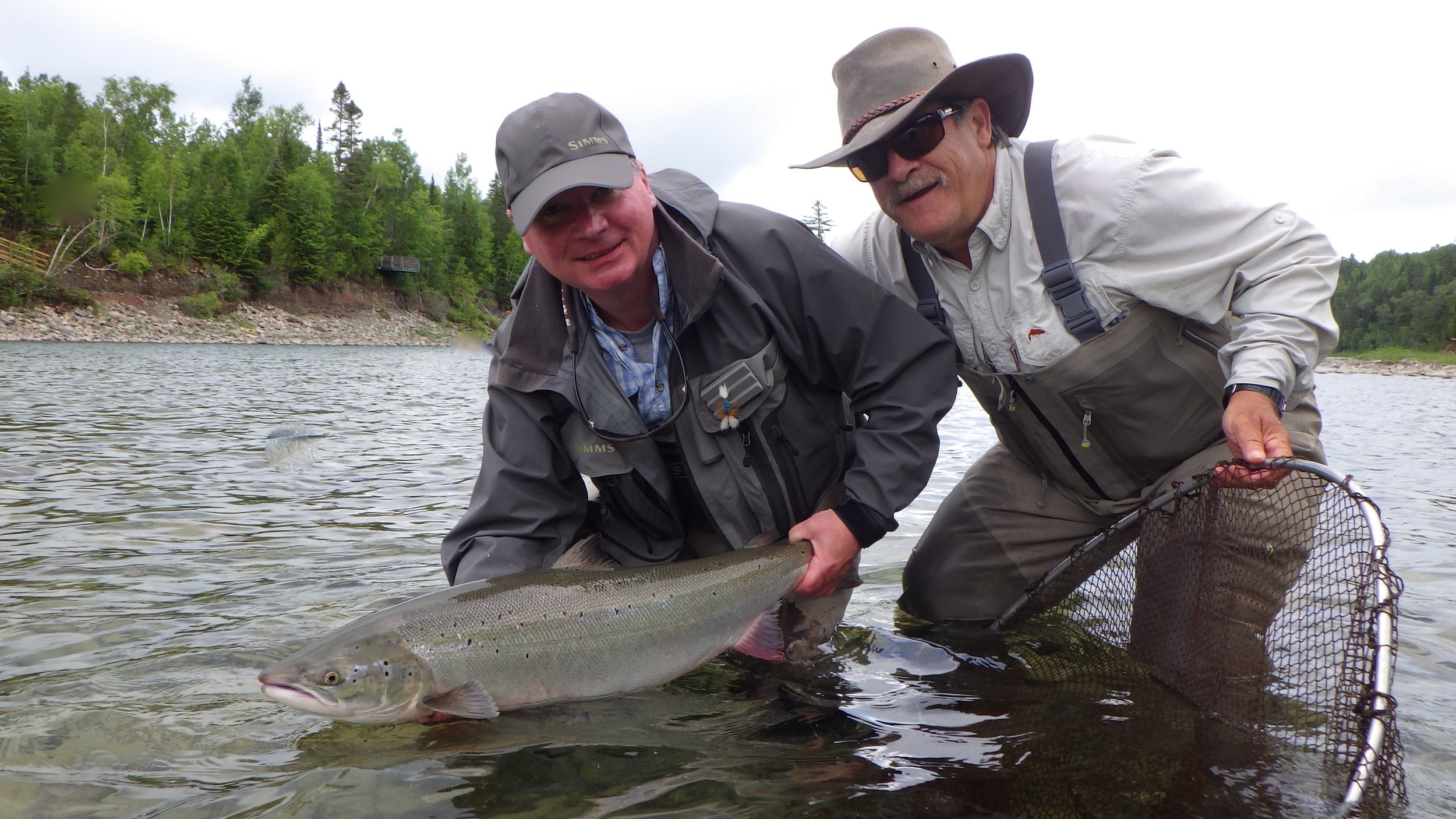 Marc Turcotte (right) has beenjoining us at camp Bonaventure for years, He and guide Mario Poirier landed this nice one after loosing 5 in a row! Finally one in the net !