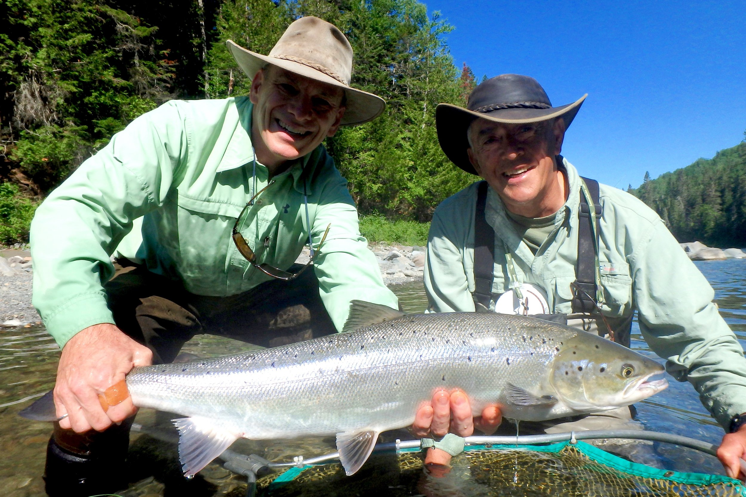 "Mike ""Spike"" Vandunsen (Left ) and Camp Bonaventure master guide Jean Marc Poirier with a nice fresh salmon on the Bonaventure, well done Spike!"