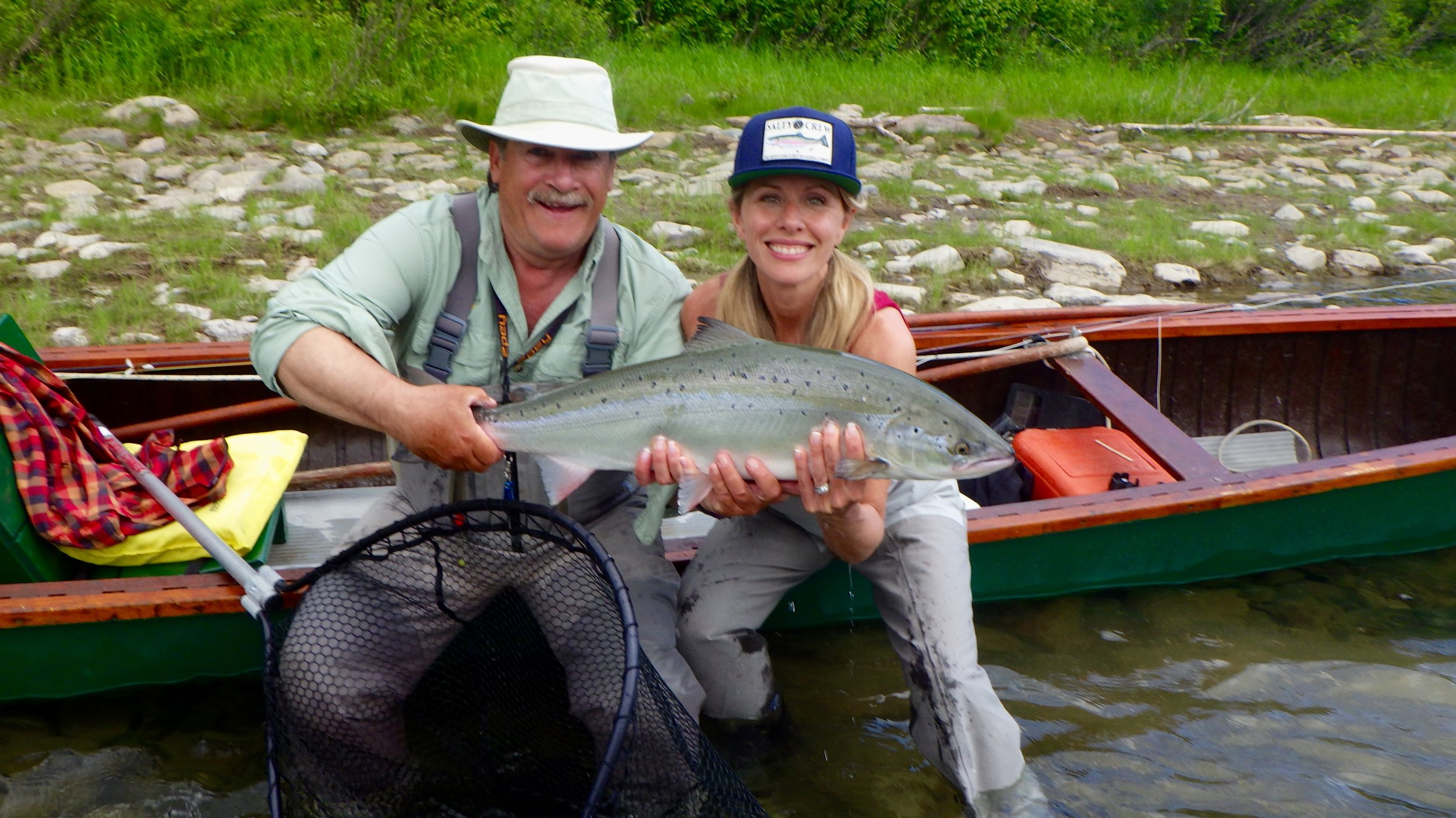 Congratulations to Patricia LePage who caught this fine salmon under the watchful eye of our head guide Mario Poirier. nice one Patricia.