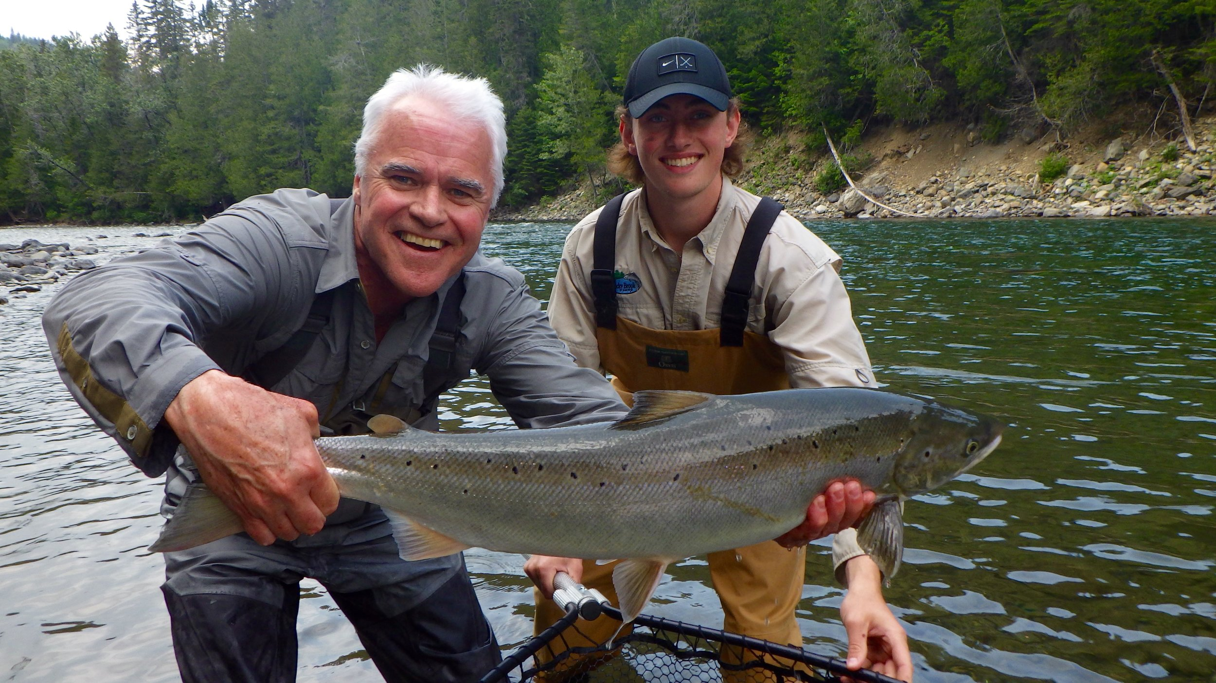 Mac Fox (Left) has become a part of our family at Camp Bonaventure, here he is with his grandson Hunter Gartley and this is Hunters first Bonaventure salmon. Congratulations !
