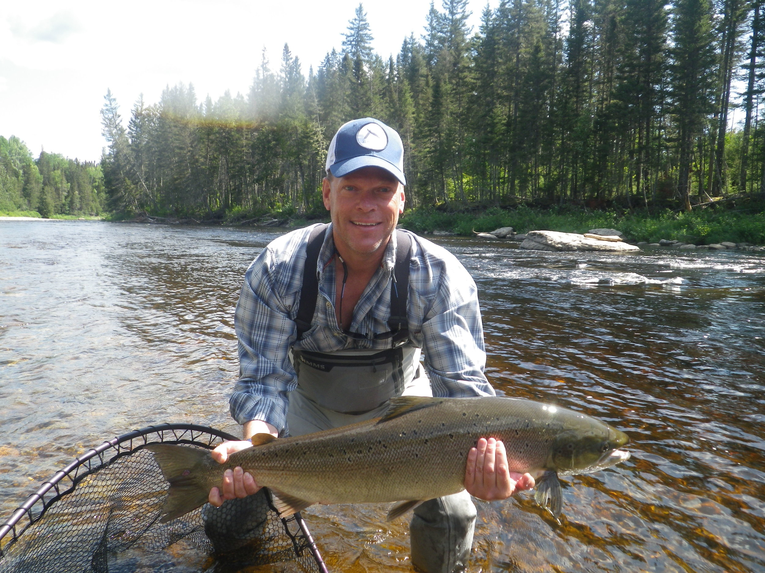 Christopher Davis releases a beauty back into the Grand Cascapedia! Congrats Chris!