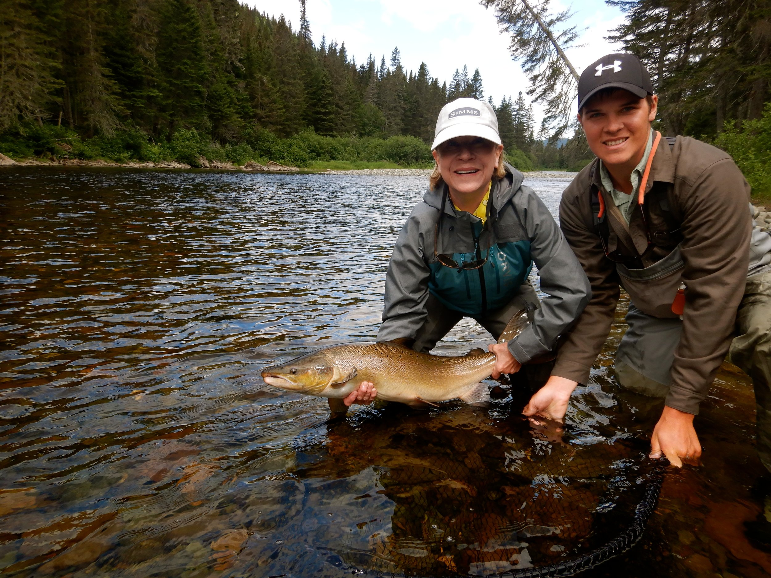 This is the first time we've had the pleasure of welcoming Kathy Benton to Camp Bonaventure and she is an absolute Gem! Here she is with her guide Nick releasing a beauty back into the Grand Cascapedia!