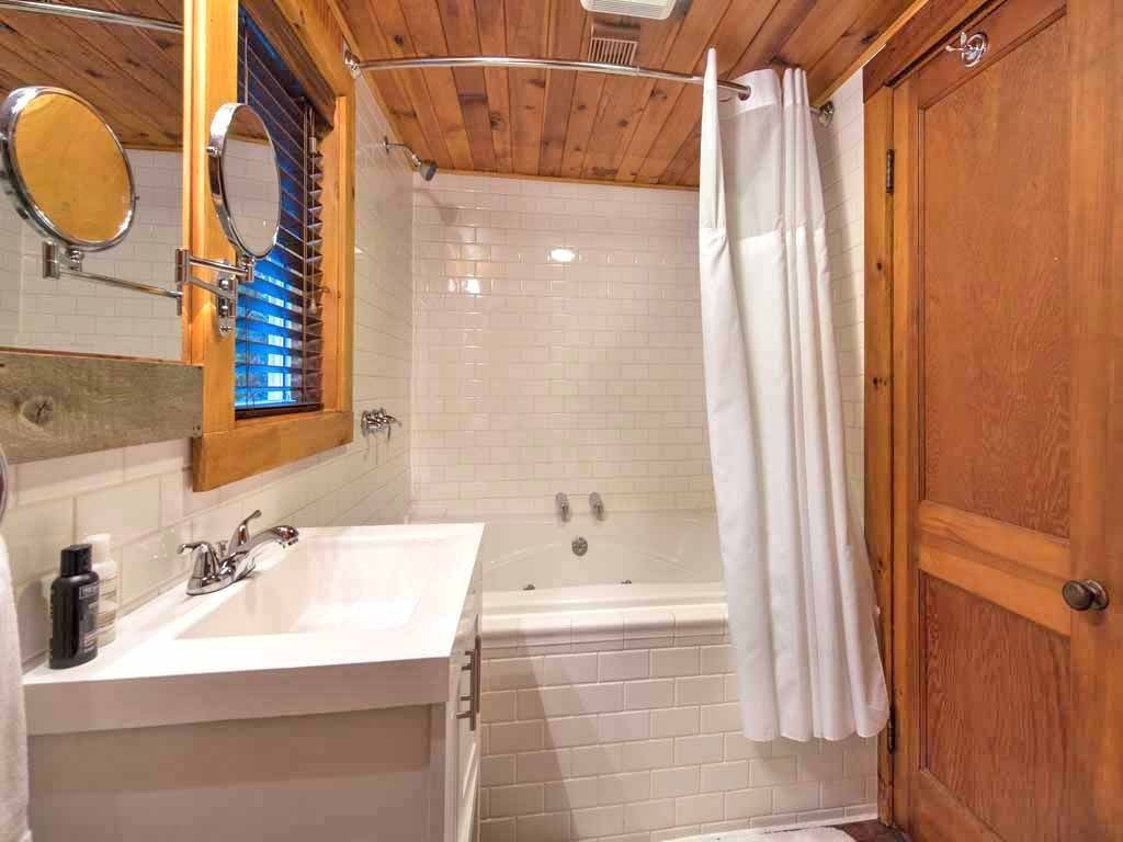 Master Bath - Two person jetted and heated soaking tubTwo shower headsGFCI protected power outletsAuxiliary heater and vent fanHair dryerTowels,washcloths and bathmatsToilet tissue for 3 daysShelving for toiletries