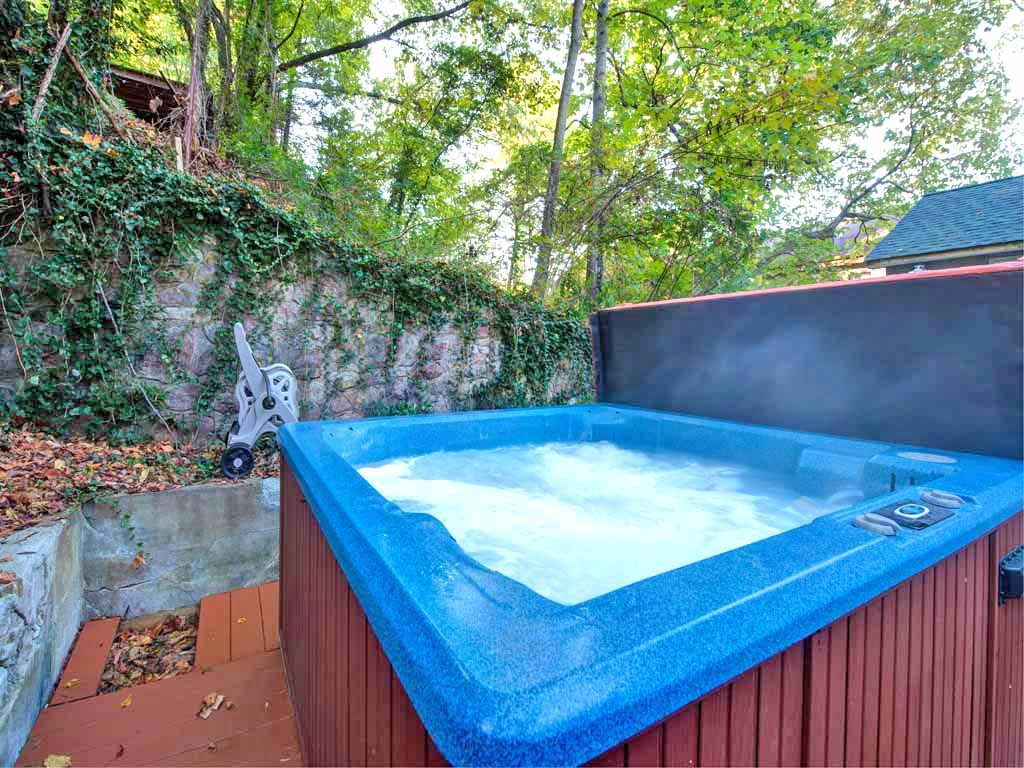 Patio - Hot tub seats sevenTable and chairs for sixCharcoal grillOutdoor power outlet conveniently located to charge electric vehicles